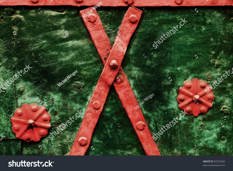 metal red ornaments on the green steel door