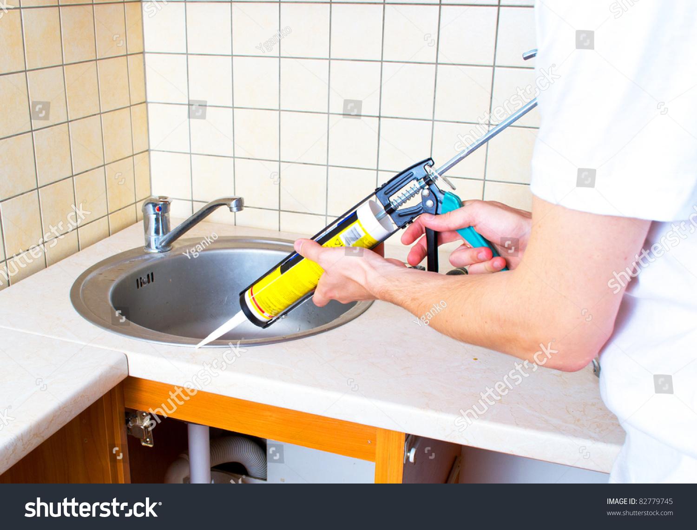 Silicone caulking kitchen sink caulk bathroom sink for Caulking kitchen cabinets