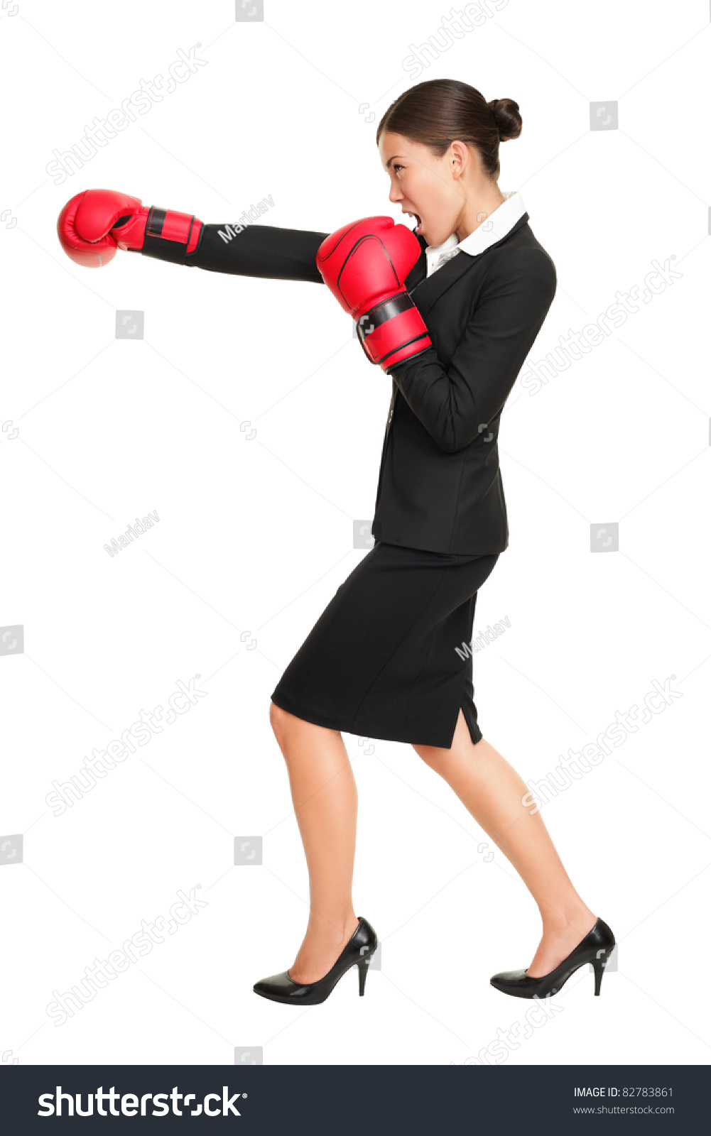 Business woman boxing - business competition concept with businesswoman  punching and hitting standing in full length