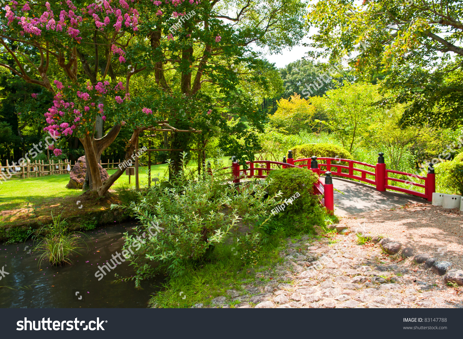 beautiful japanese garden with a lake and a red bridge in the front - Red Japanese Garden Bridge