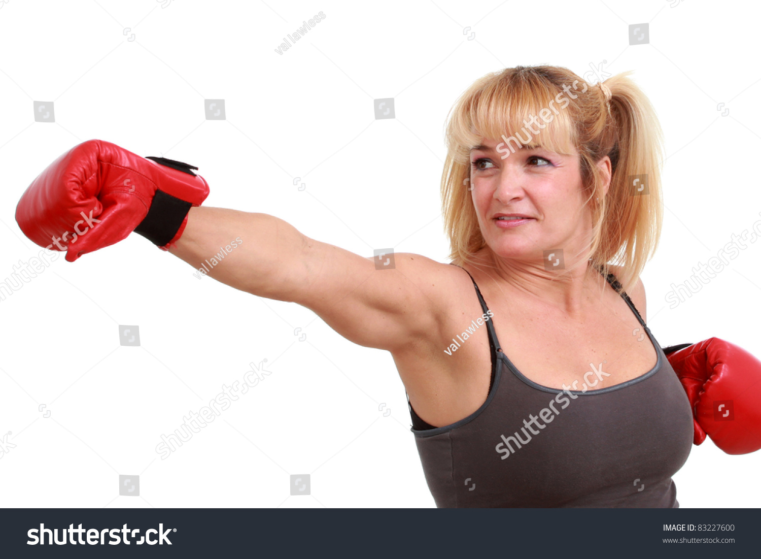 Woman Throwing A Punch Stock Photo 83227600 : Shutterstock