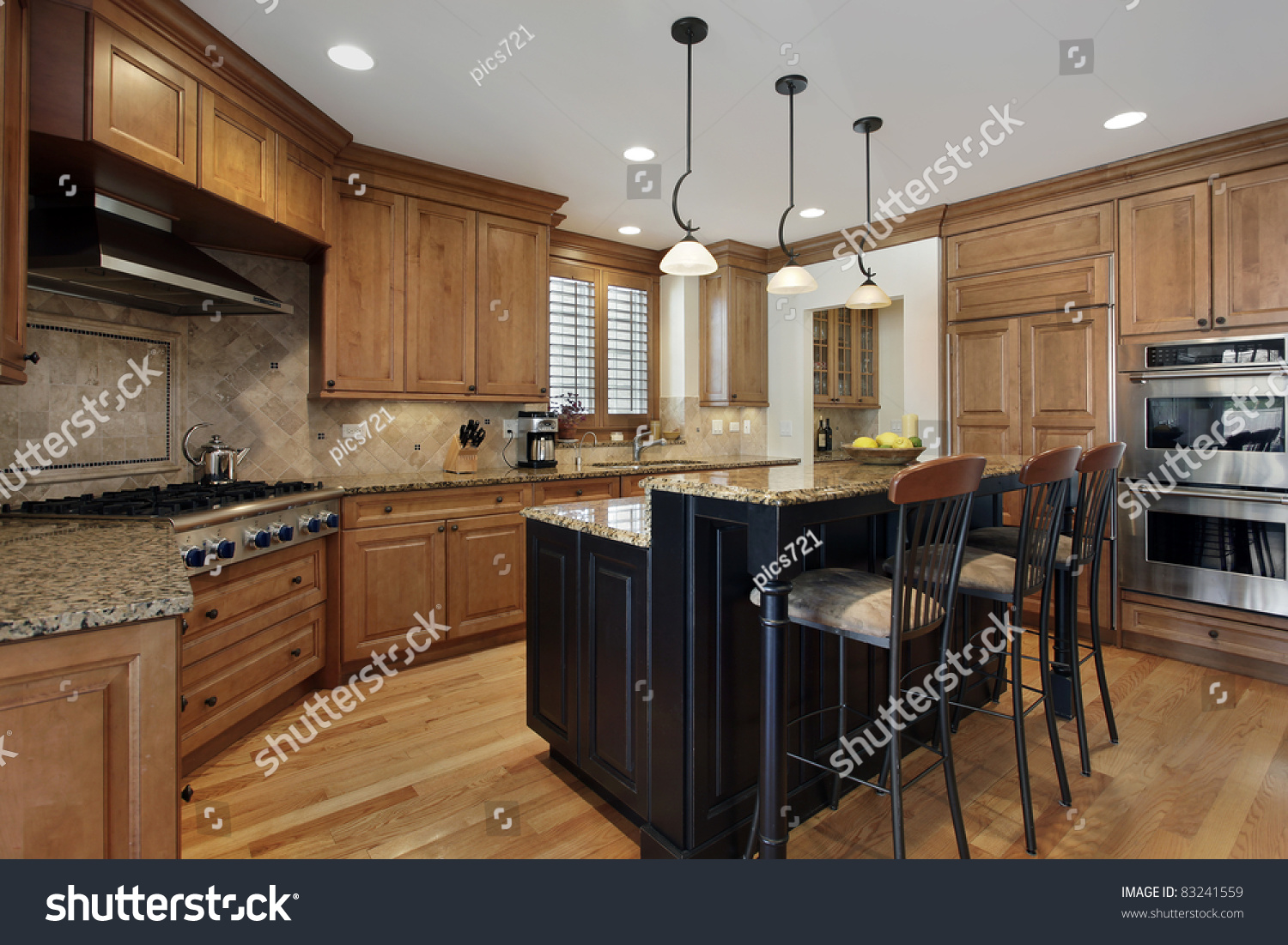 Granite Island Kitchen Luxury Kitchen With Granite Island And Wood Cabinetry Stock Photo
