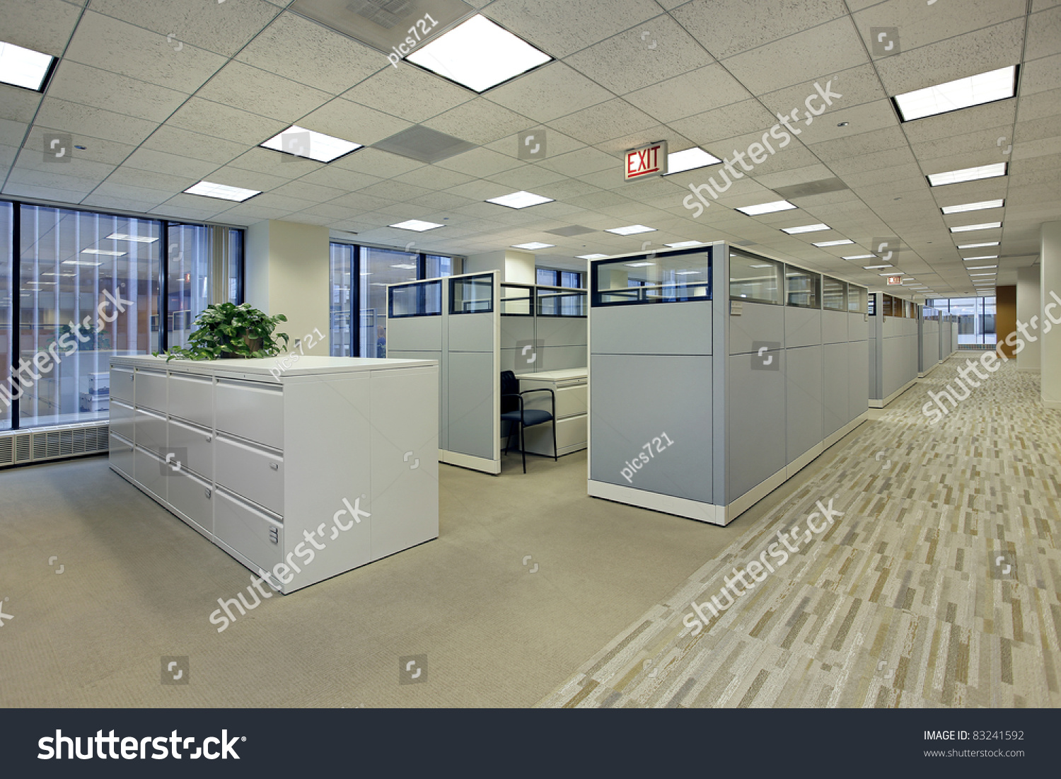 Office area with cubicles in high rise building stock for Find a builder in your area