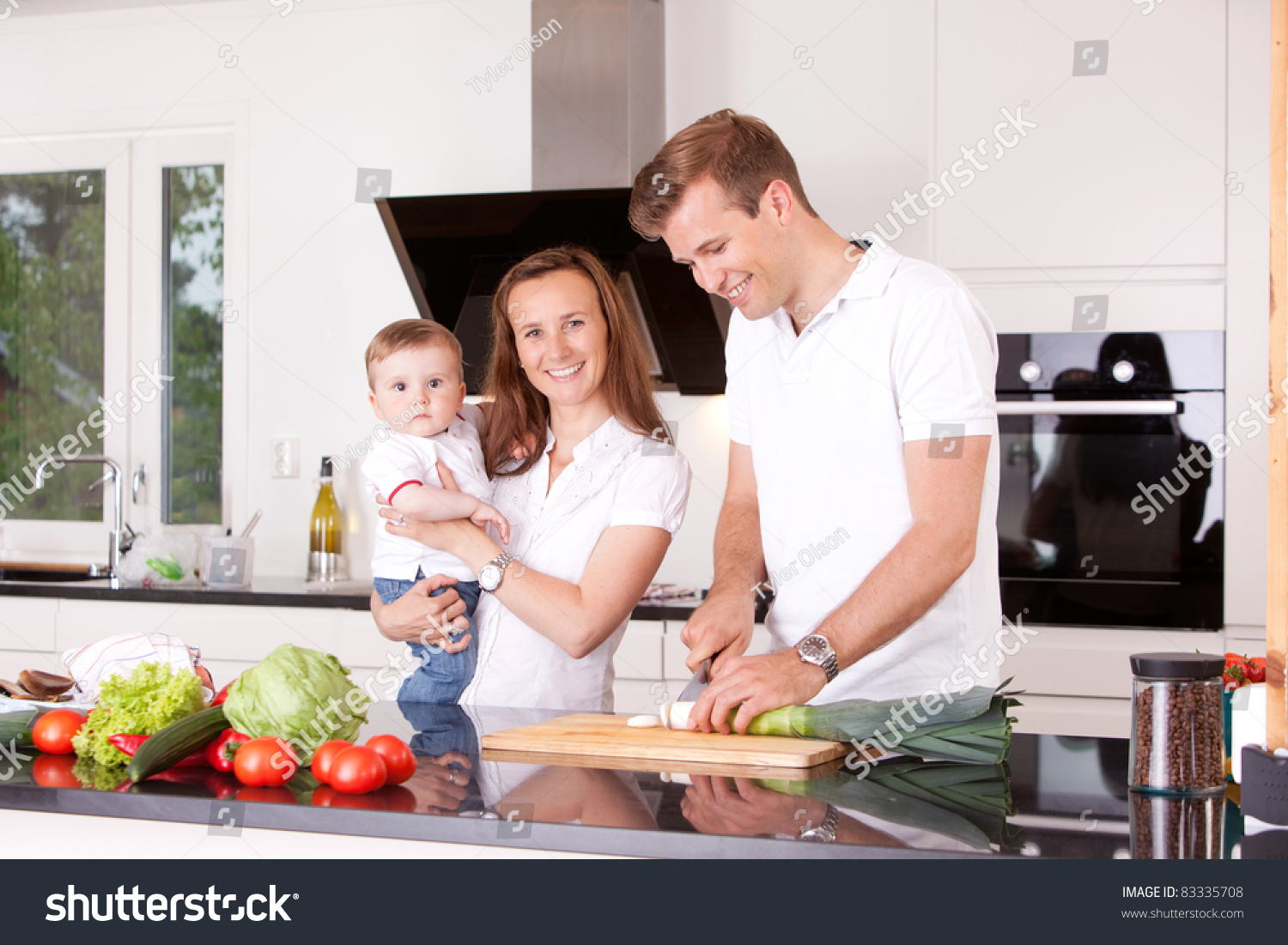 Family cooking kitchen - Happy Family At Home In The Kitchen Cooking Making A Meal