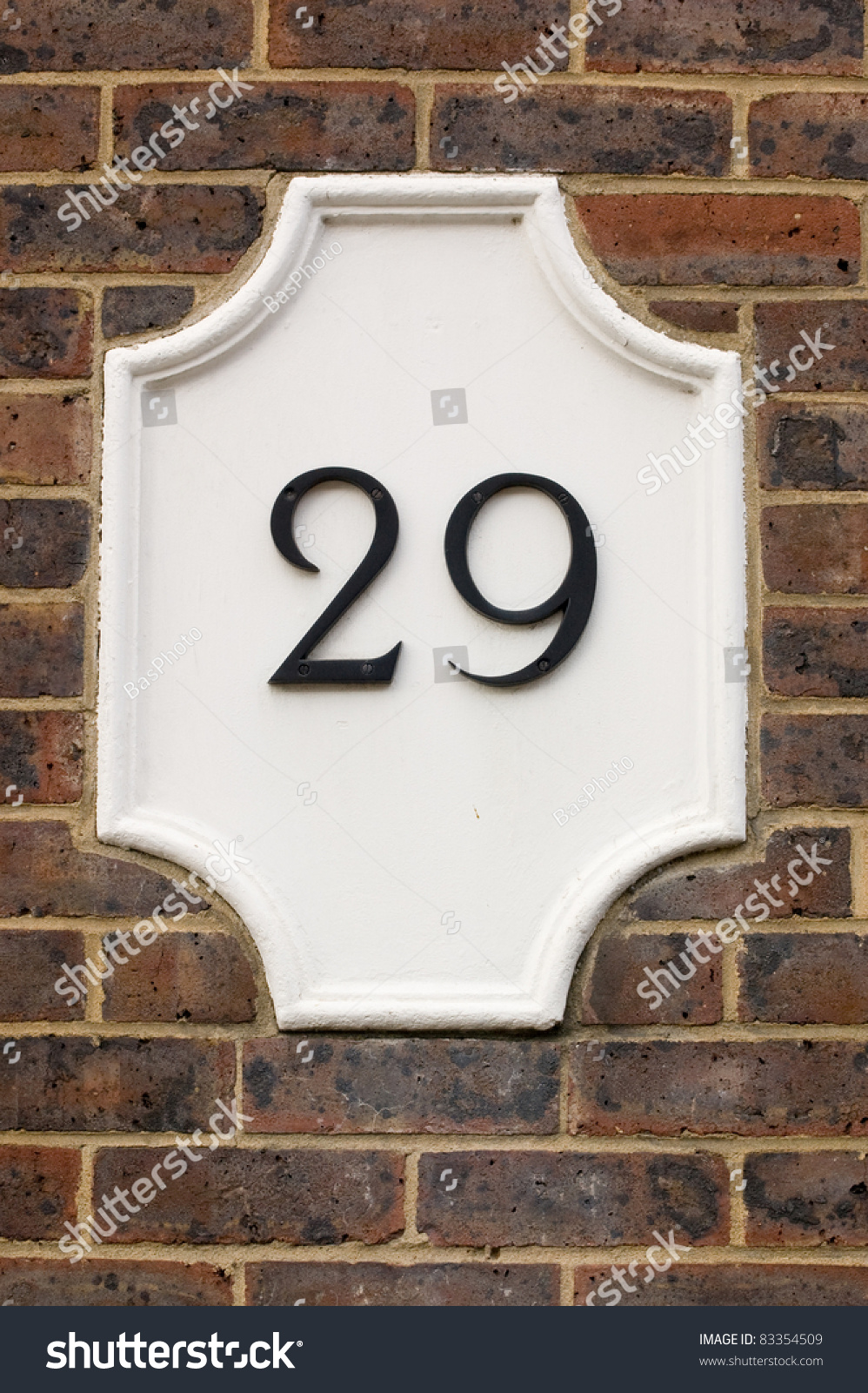 Wall Plaque Showing Number Twenty Nine 29 Outside Wall Of A House Stock Photo 83354509
