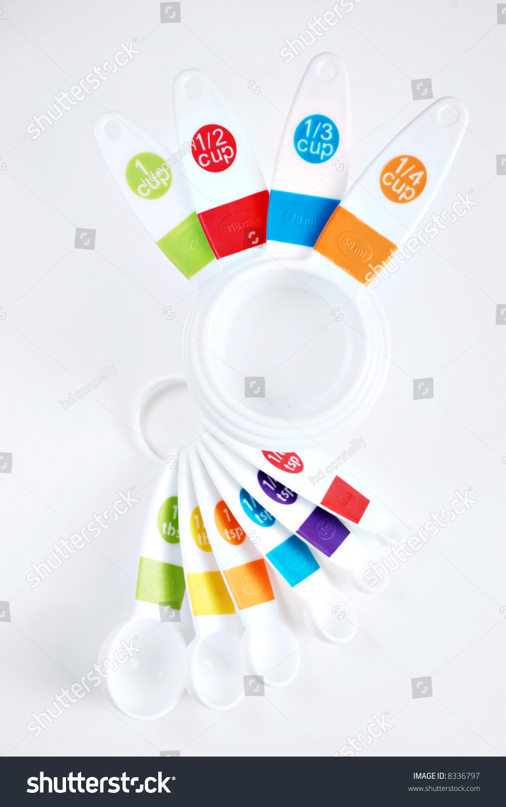 Colorful Spoons: Colorful Measuring Cups And Spoons On White Background