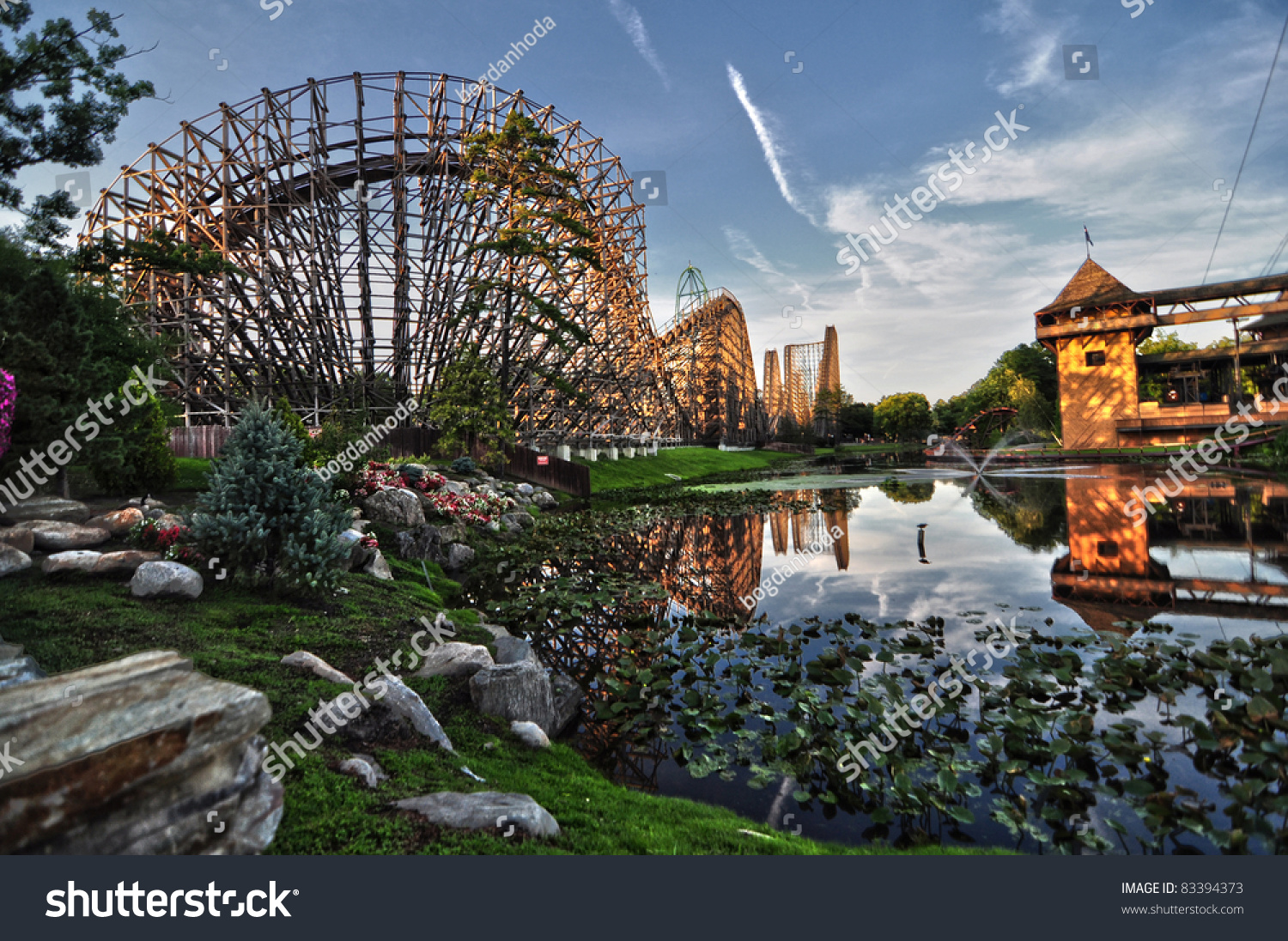 Side View Of A Wooden Roller Coaster Being Mirrored In A ...