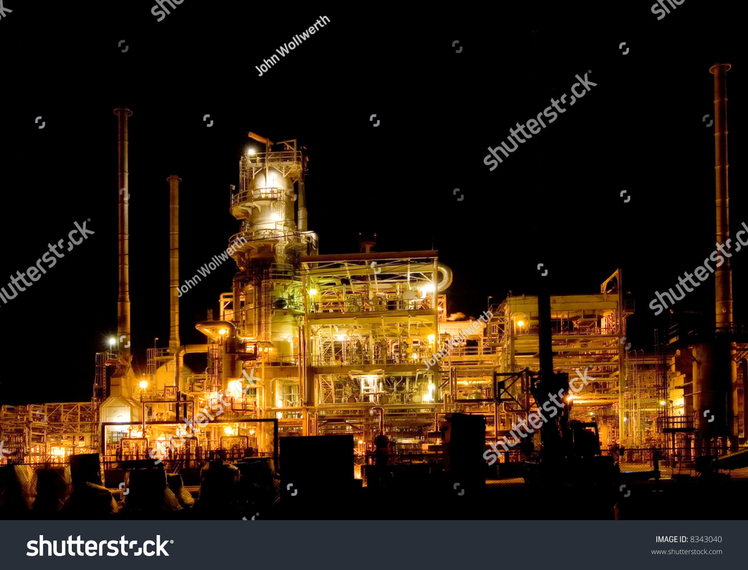 stock-photo-oil-refinery-lighting-up-the