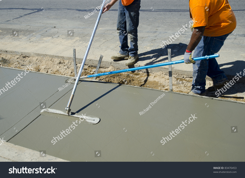 Workmen Finish Smooth Concrete Surface On Stock Photo (Edit
