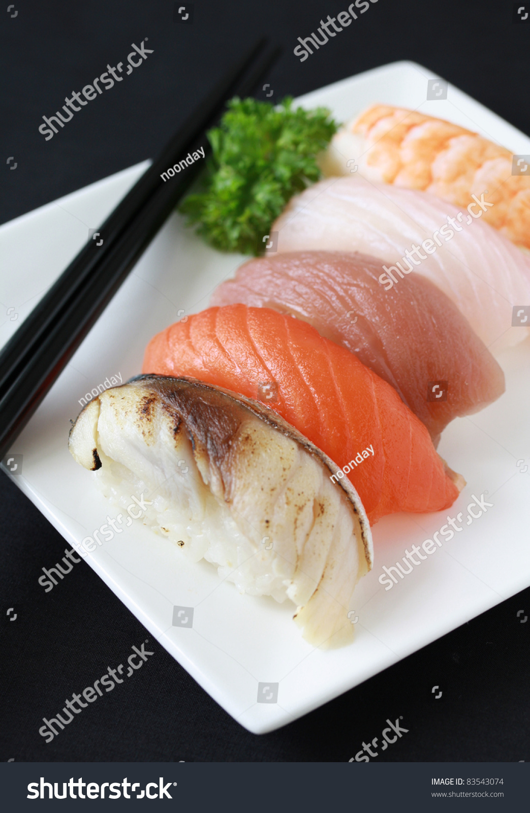Sushi of grilled fish and raw fish on white plate with for Is sushi raw fish