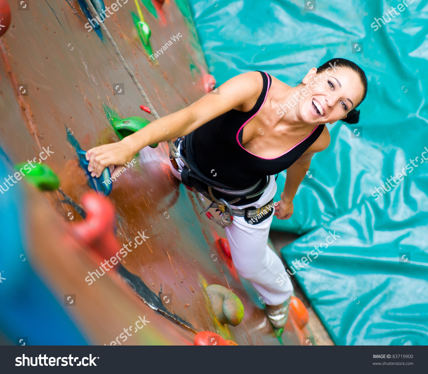 Women outdoor rock climbing