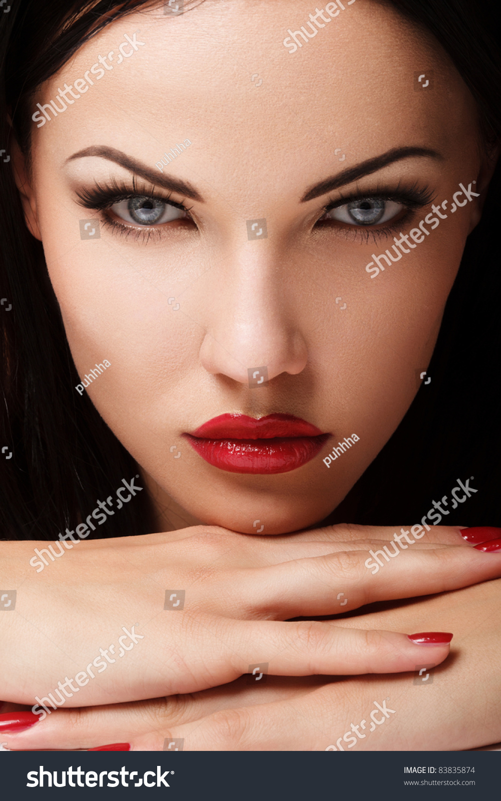 Portrait Of Beautiful Woman With Red Lips. Nice Makeup
