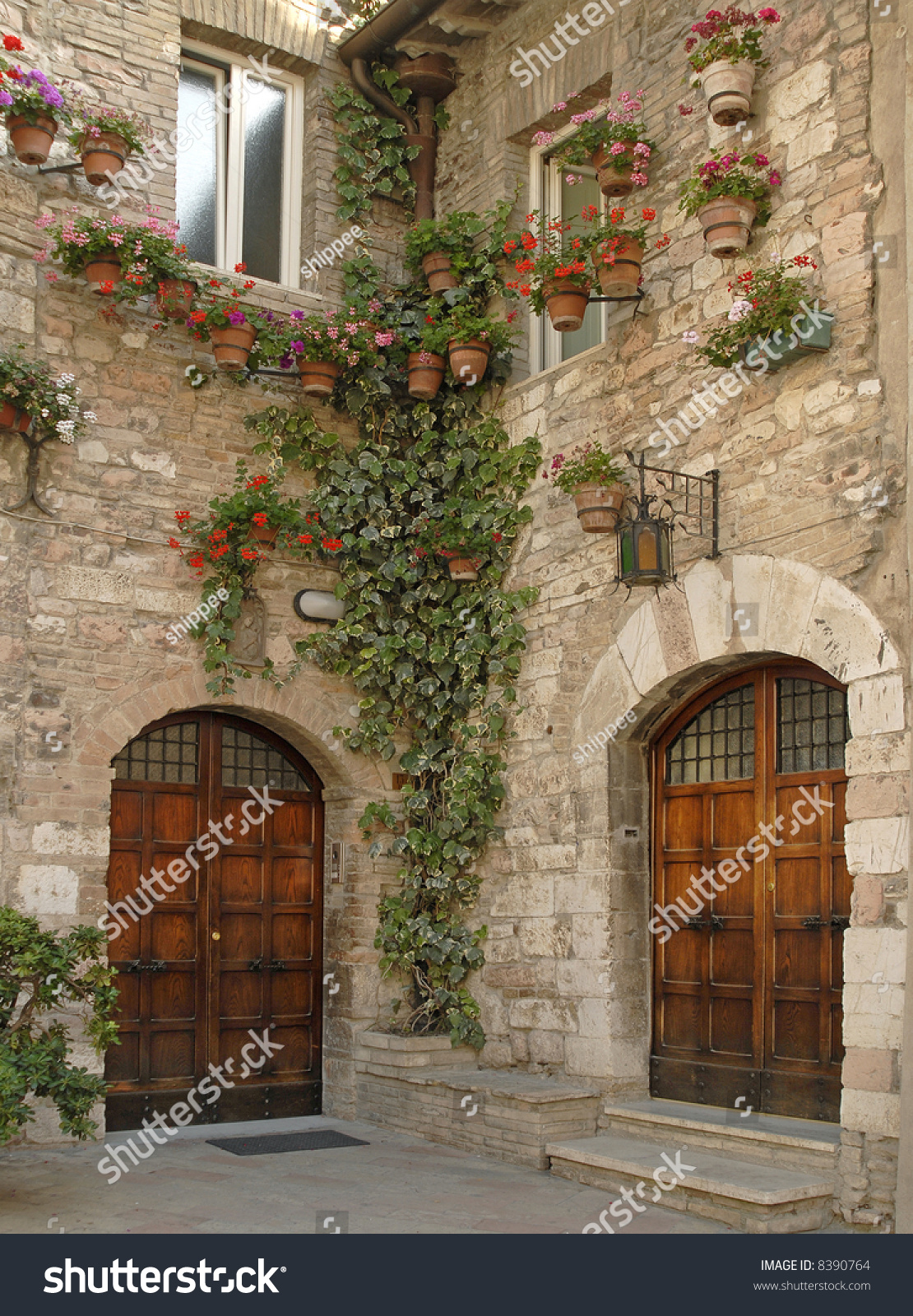 1600 #AD321E Beautiful Wooden Doors Cobblestone Walls With Potted Plants And Ivy  image Beautiful Wooden Doors 46731110