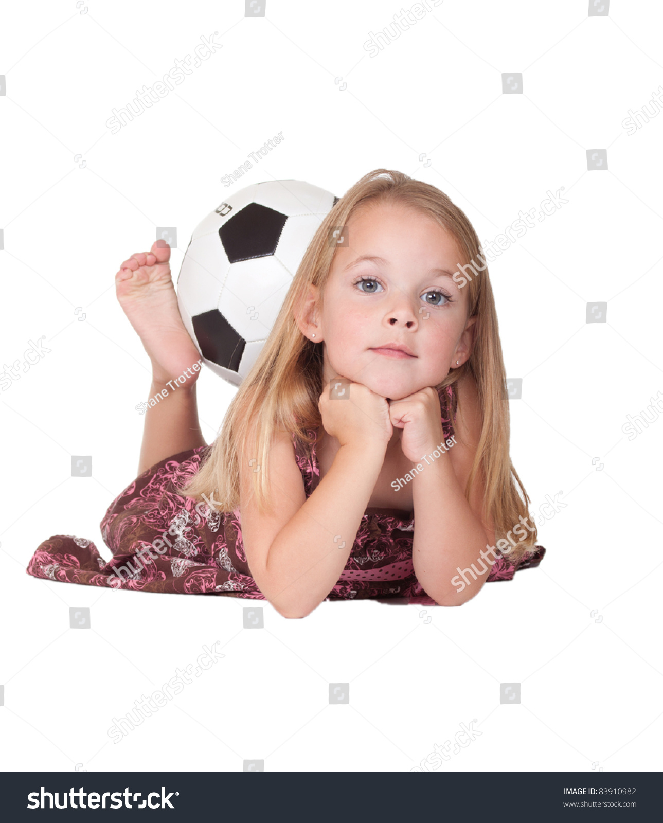 fbcba3279d A nice image of a cute girl laying down with her soccer ball held by her
