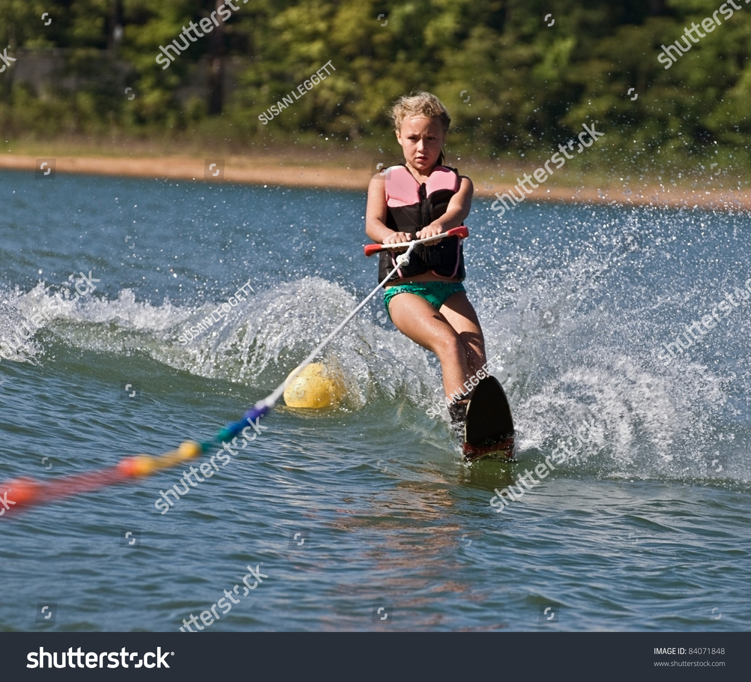 Young Girl Water Skiing On Slalom Stock Photo 84071848
