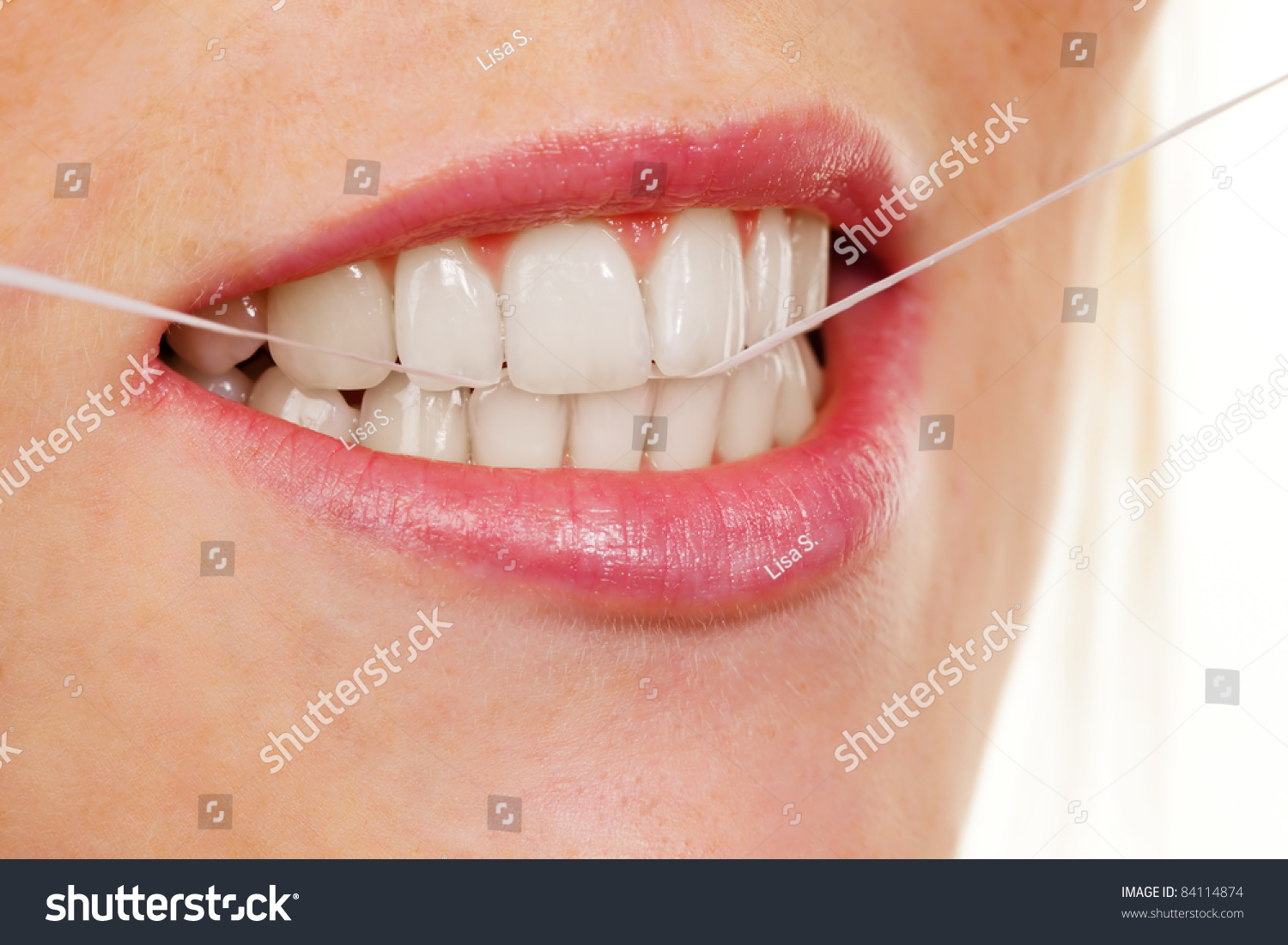 how to get dental floss out of your teeth