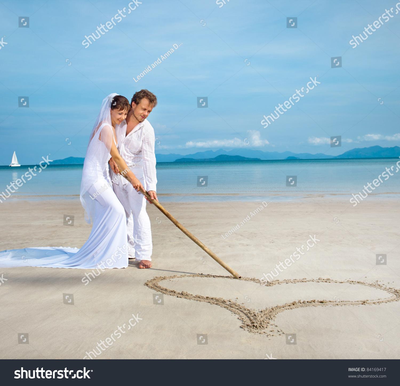 Beautiful Couple On Beach Wedding Dress Stock Photo