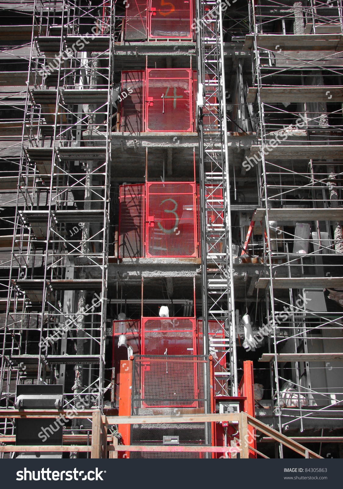 industrial elevator scaffold on high rise stock photo  industrial elevator and scaffold on high rise construction site