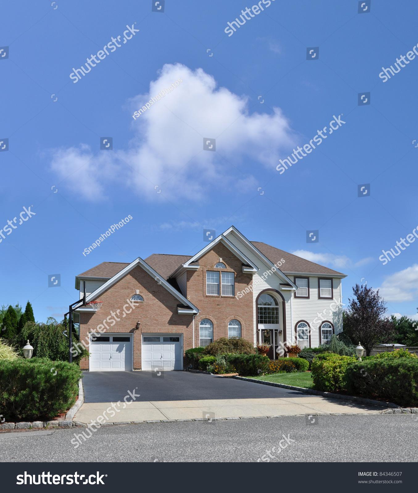 Luxury Brick Homes: Manicured Suburban Two Car Garage Two Story Luxury Brick