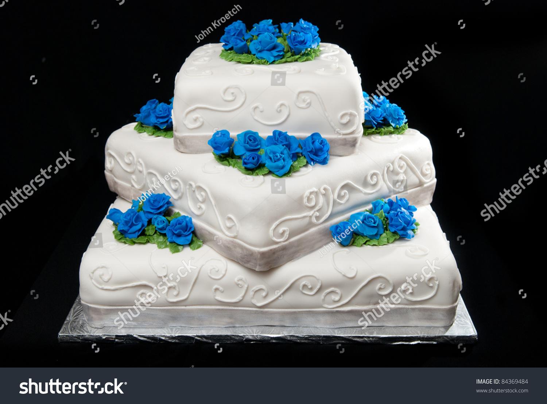 Threetier Square Wedding Cake Blue Roses Stock