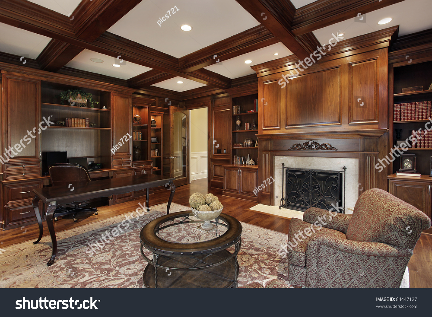 Library In Luxury Home With Marble Fireplace Stock Photo