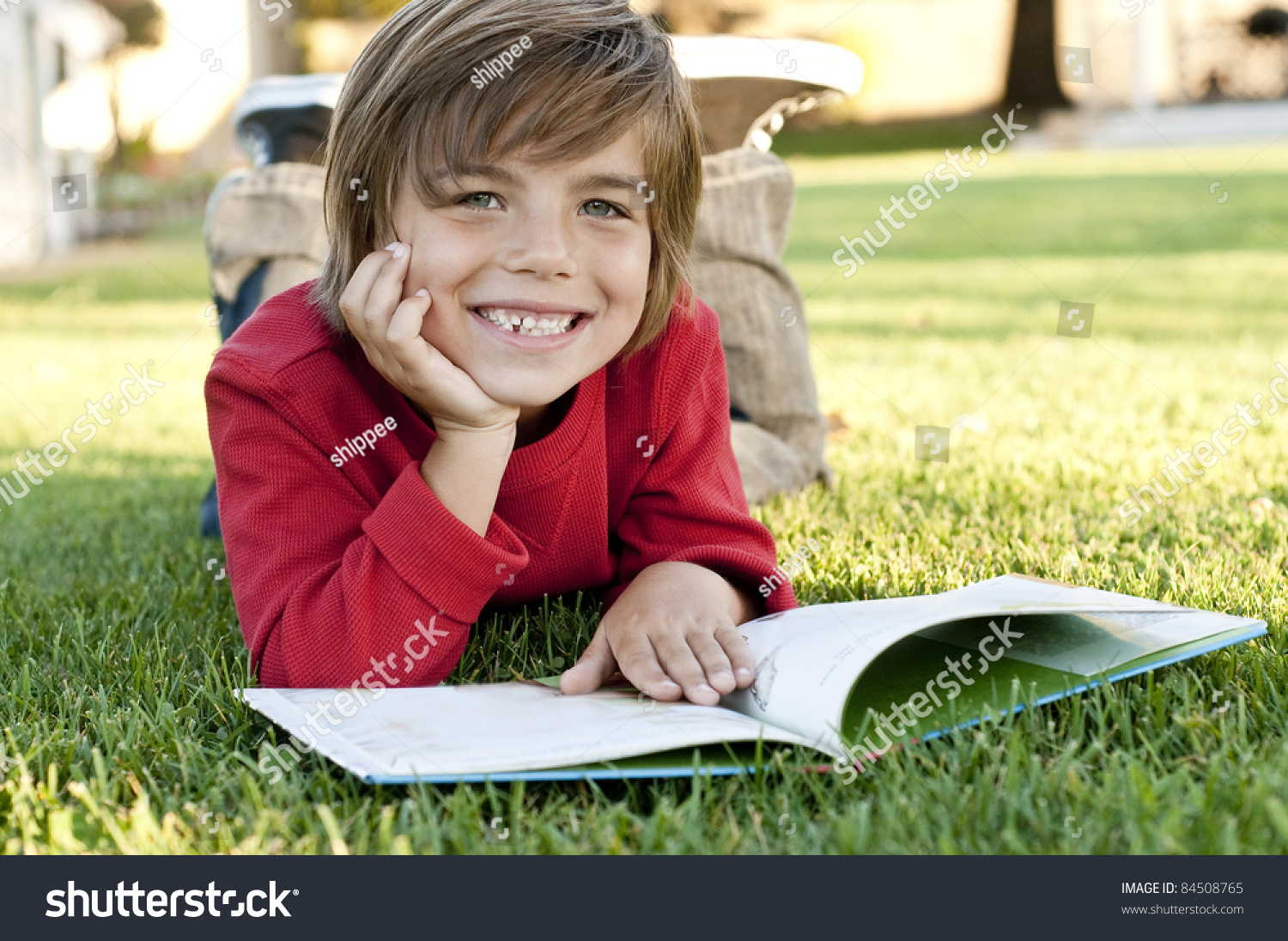 Worksheet Books 7 Year Old very cute 7 year old boy stock photo 84508765 shutterstock lying on the grass reading a kids book
