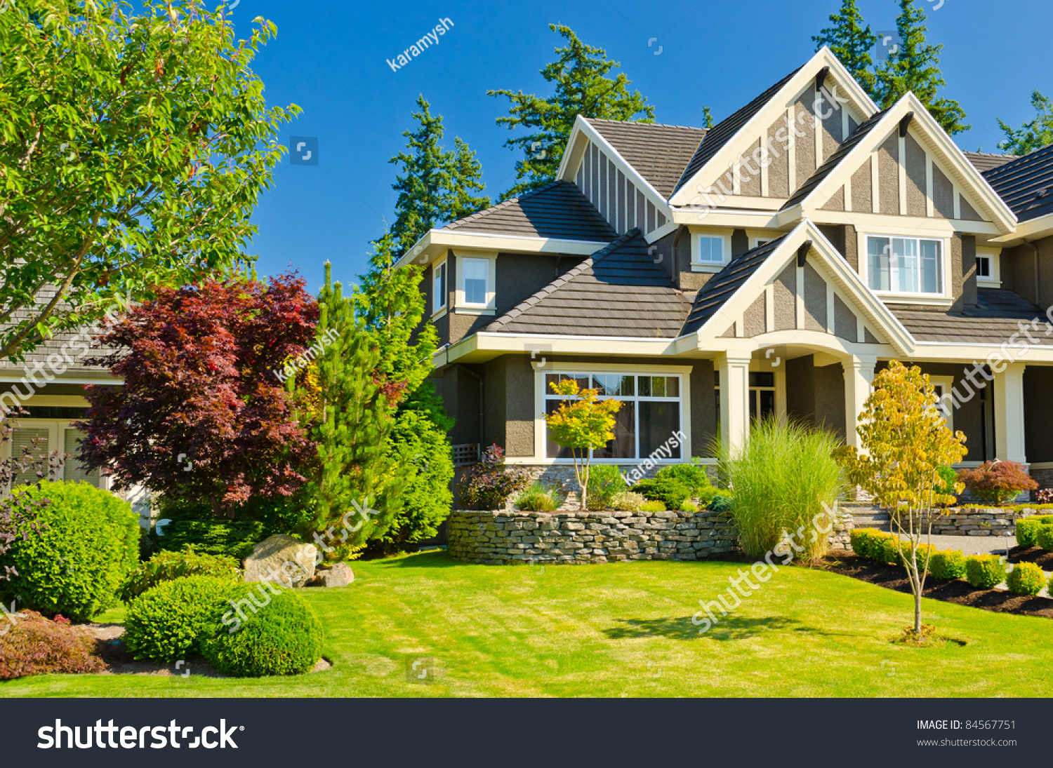 Fragment of a nice house with gorgeous outdoor landscape for Nice home pictures