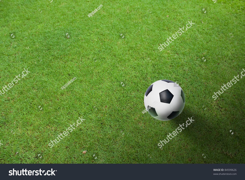 green grass football field. A Ball On The Green Grass Of Football Field