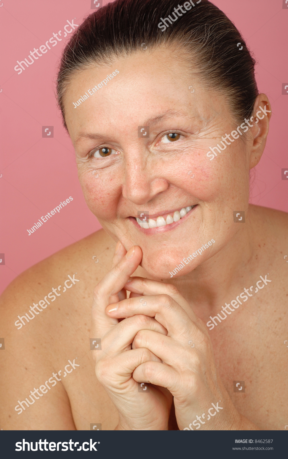 attractive older woman laughing while nude stock photo (royalty free