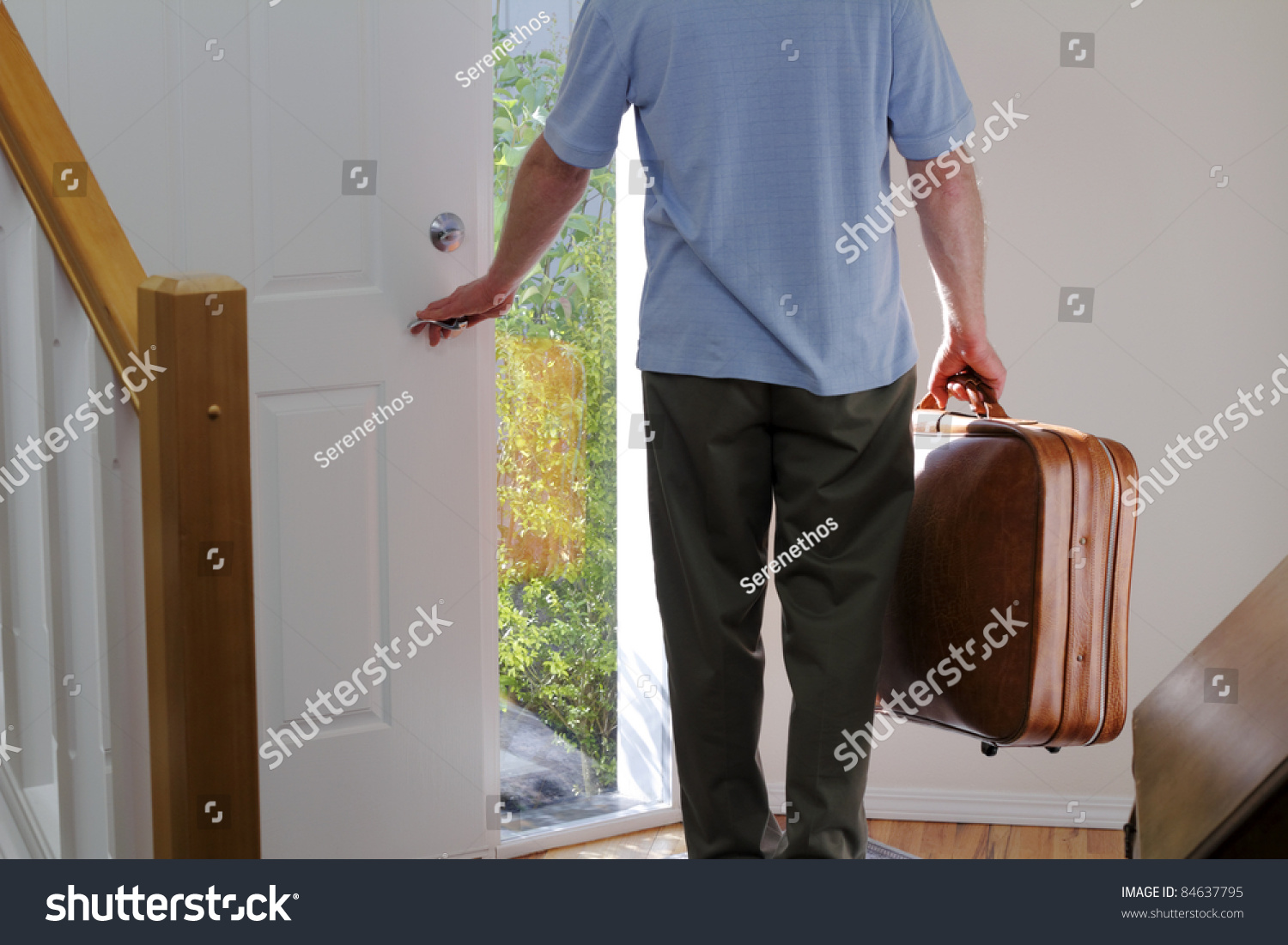 Man Carrying Suitcase About Walk Out Stock Photo 84637795