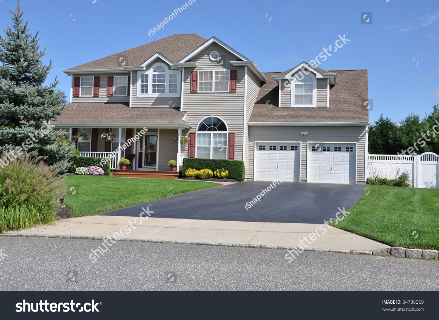 Large Two Story Two Car Garage Suburban Home Driveway