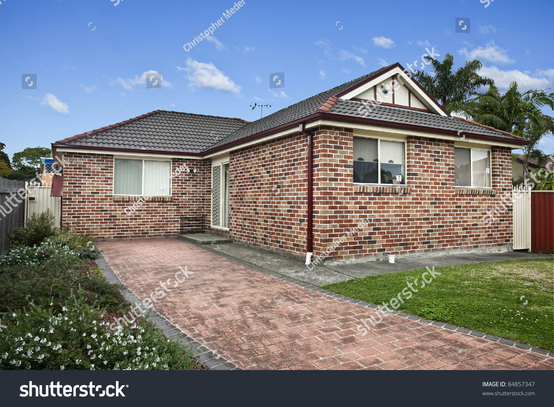 Modern home against a blue sky stock photo 84857347 for Blue modern house