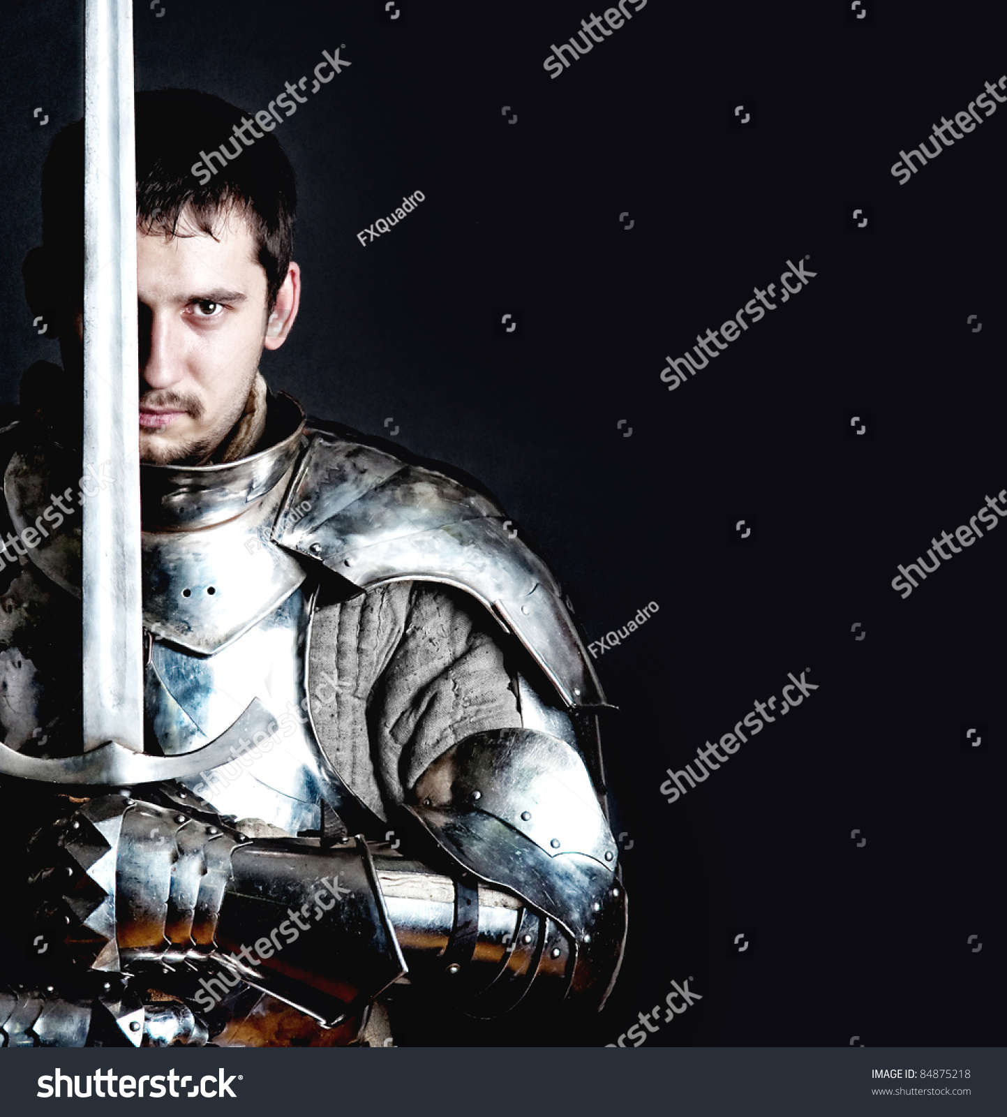 Glistening Knight Holding Twohanded Sword Stock Photo