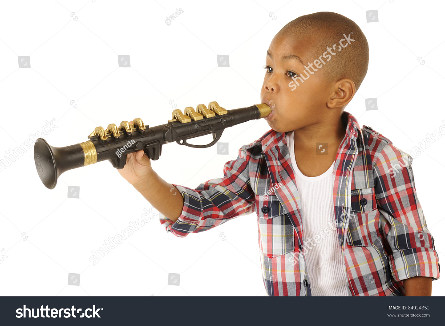 a handsome african american preschooler playing a black
