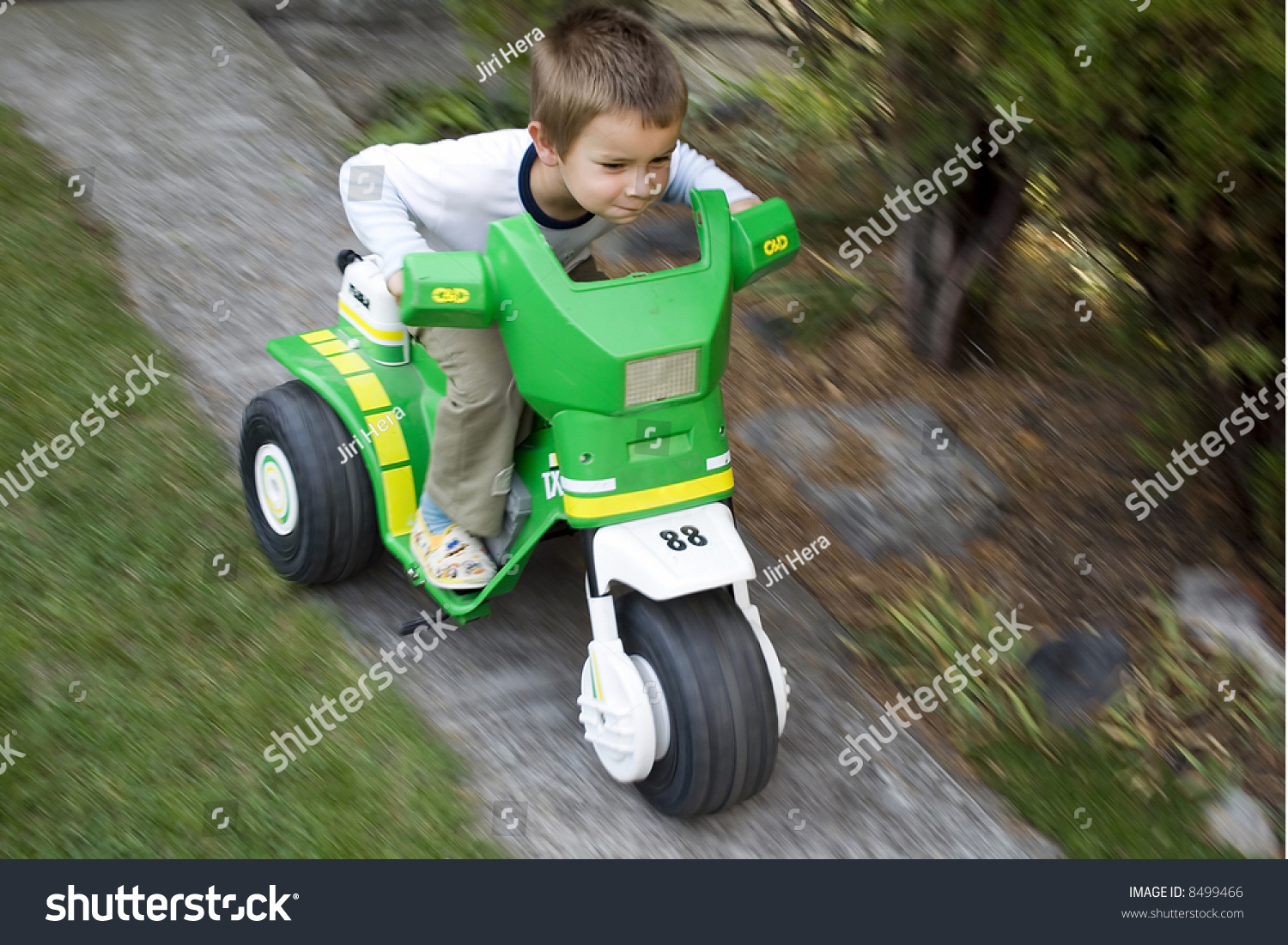 Little Boy With Toy Car : Little boy driving green toy car stock photo