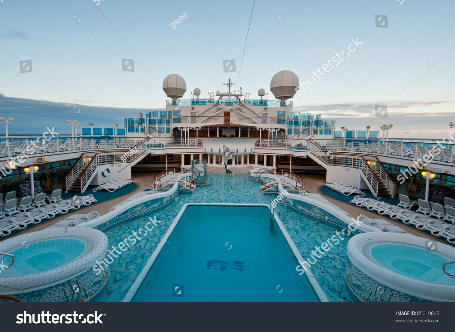 View Of Top Deck Of Cruise Ship With Luxurious Pools And ...