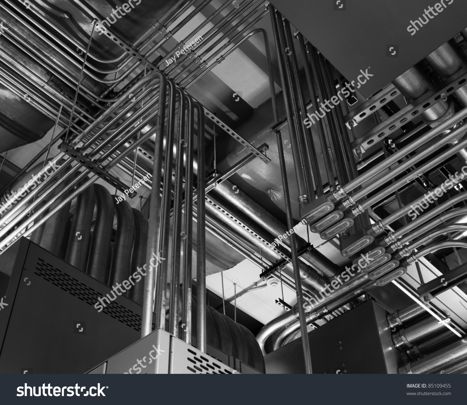 Odd angles electrical conduits captured black stock photo
