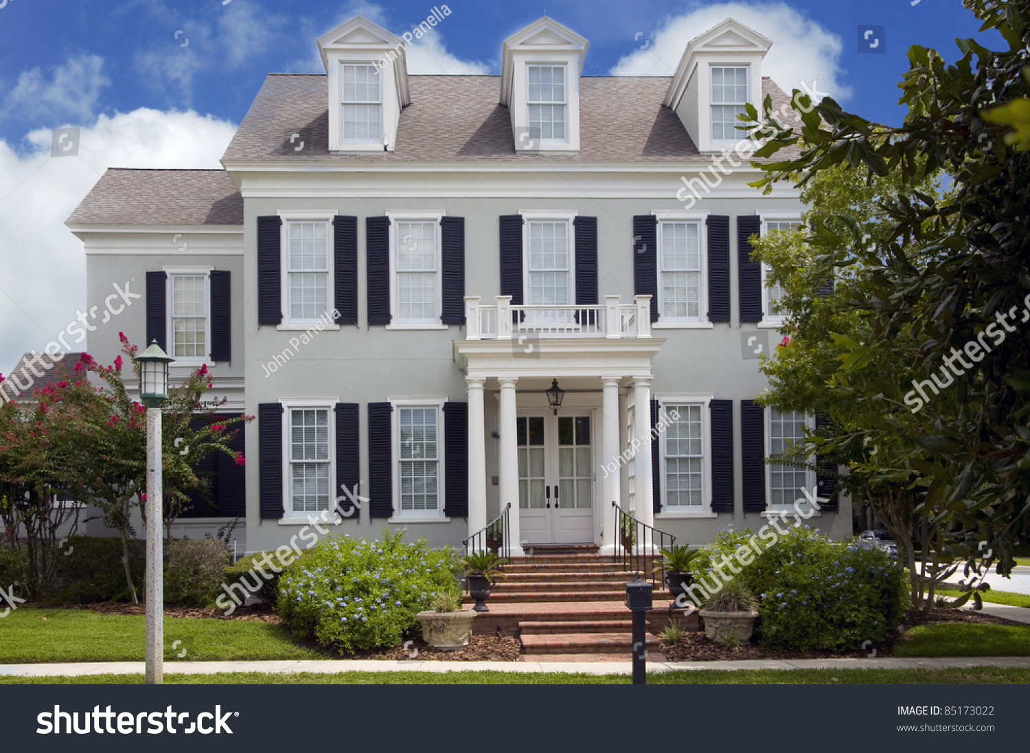 Two story colonial style home shutters stock photo for Colonial home styles guide