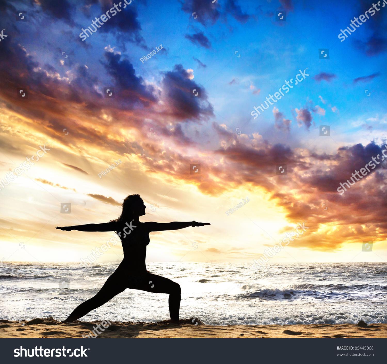 Beautiful Woman Face Over Beach Sunset Stock Image: Virabhadrasana Ii Warrior Pose By Beautiful Woman