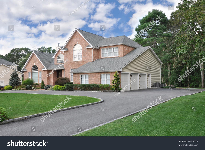 three car garage suburban luxury home stock photo 85608283