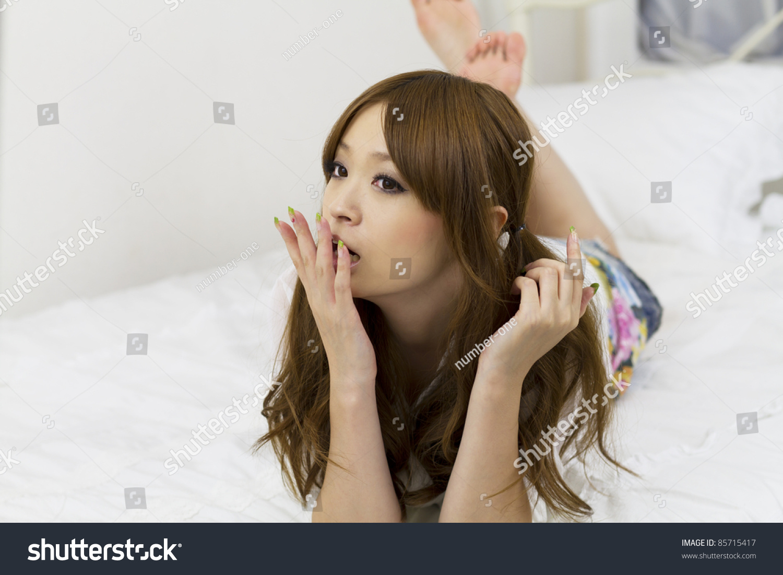 Beautiful Asian Woman Relaxing Bed Room Stock Photo 85715417 - Shutterstock-5823