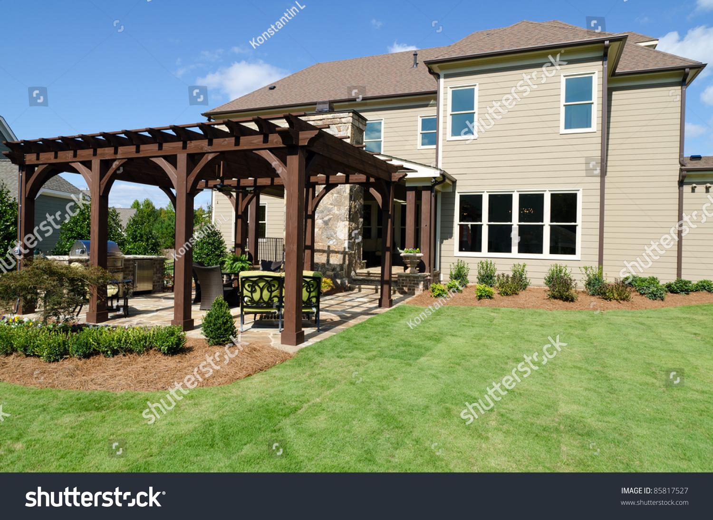 large house with landscaped backyard stock photo 85817527