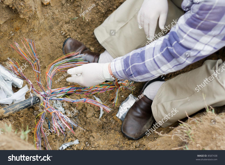 Technician Repairs Underground Telephone Line Stock Photo (Download ...