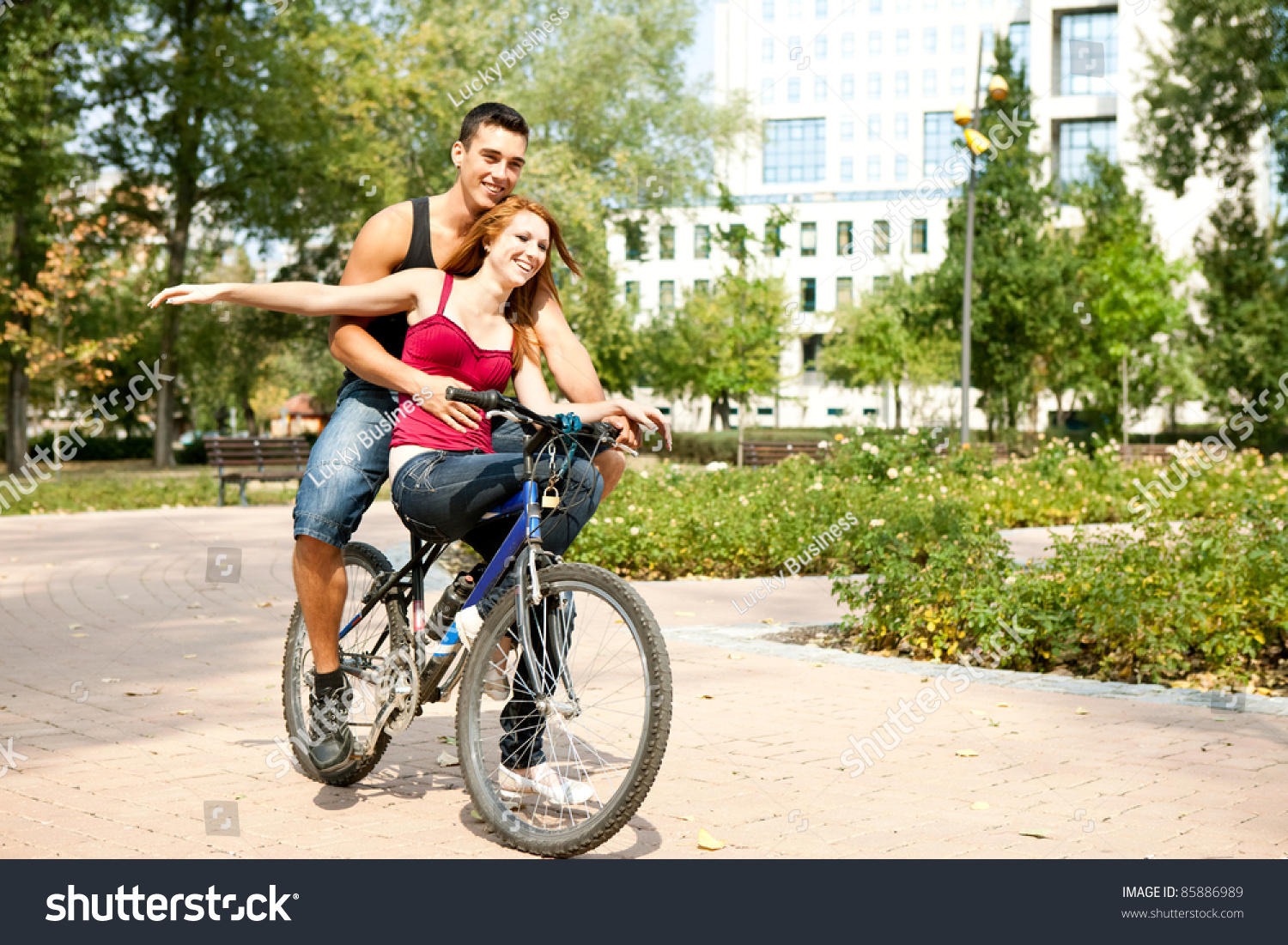 Excited Young Love Couple Riding Bicycle Stock Photo Edit Now