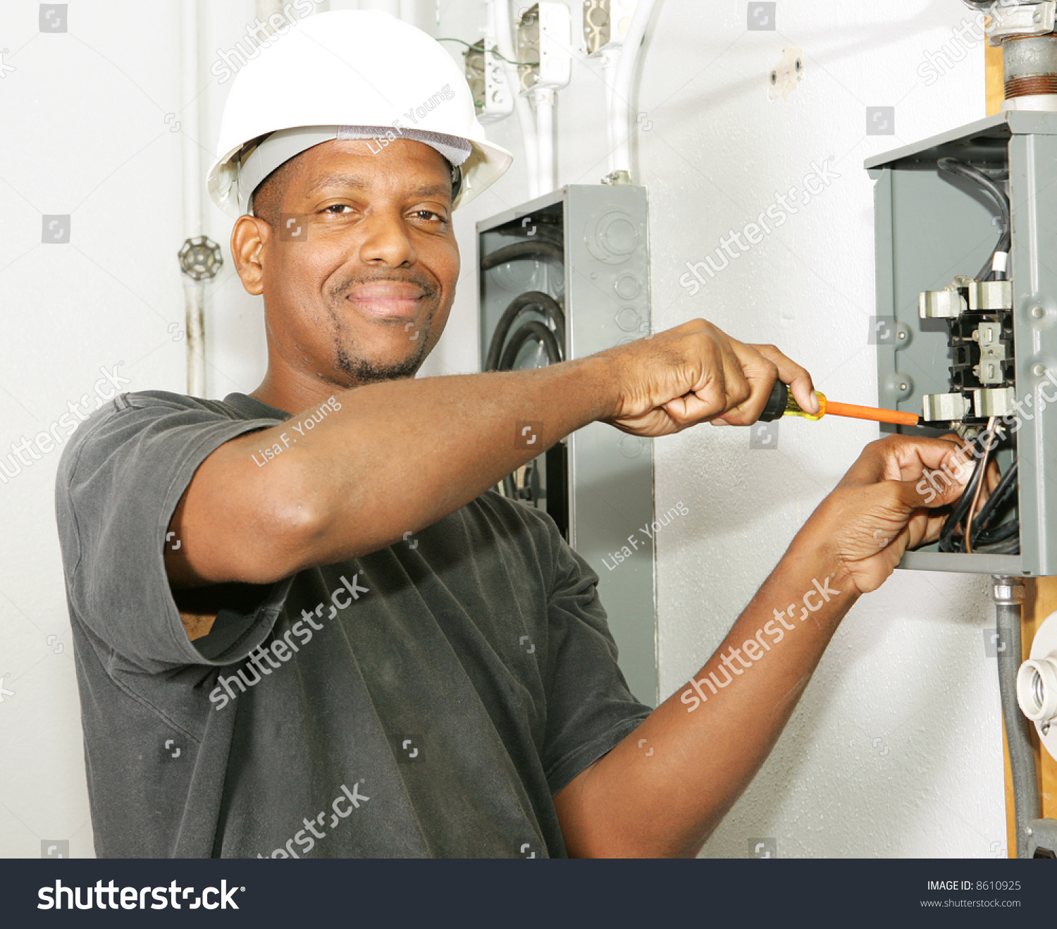 Handsome African American Electrician Working On Stock Photo ...