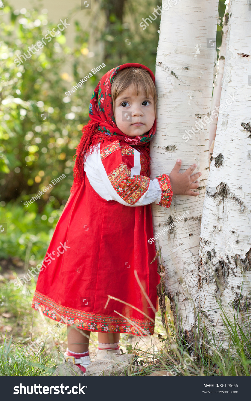 little girl russian traditional dress standing stock photo little girl in russian traditional dress standing next to a birch