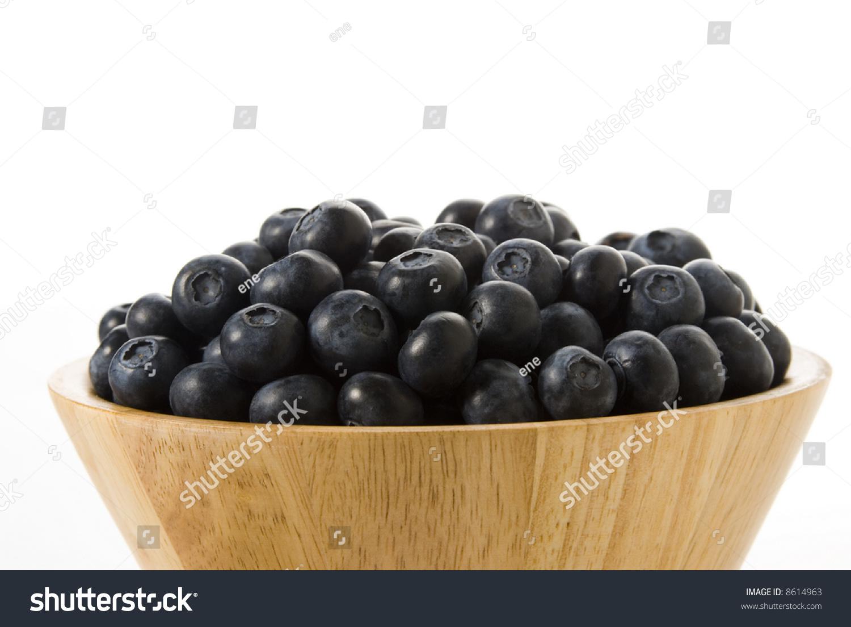 mix of blueberries blackberries raspberries in wooden