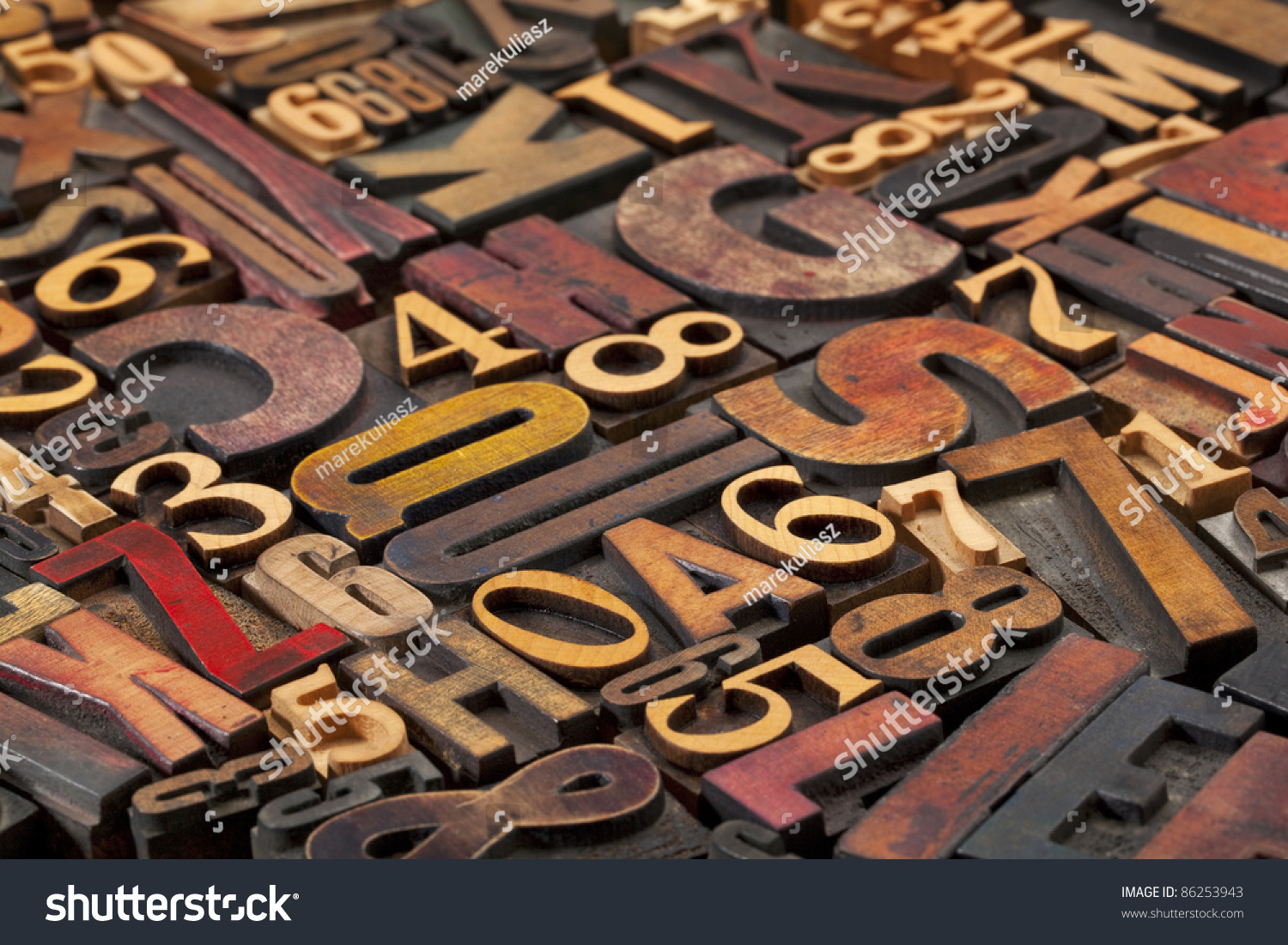 random letters and numbers in antique wood letterpress printing blocks of various size and style