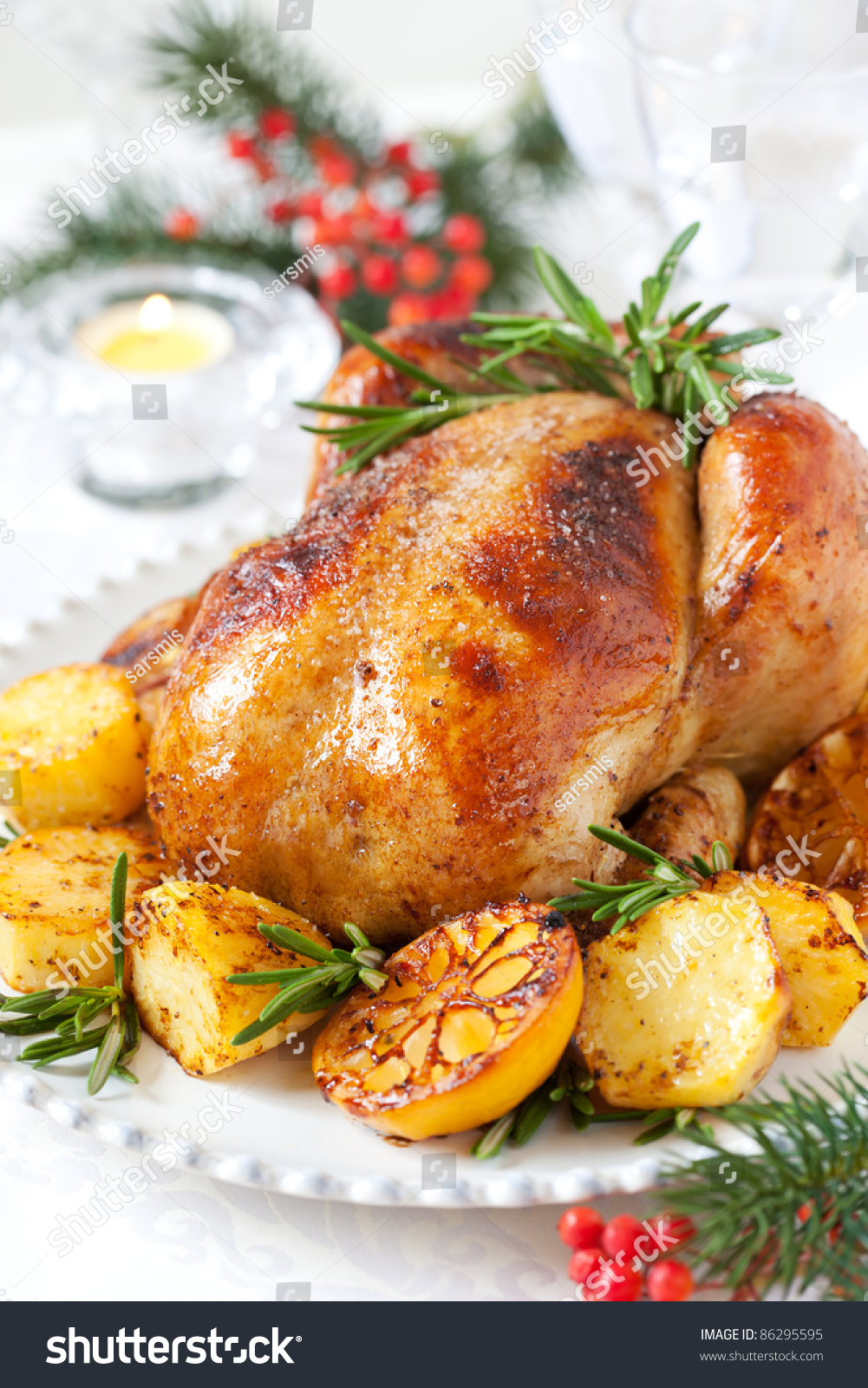Roast Chicken With Potatoes,Lemons And Rosemary For Christmas ...
