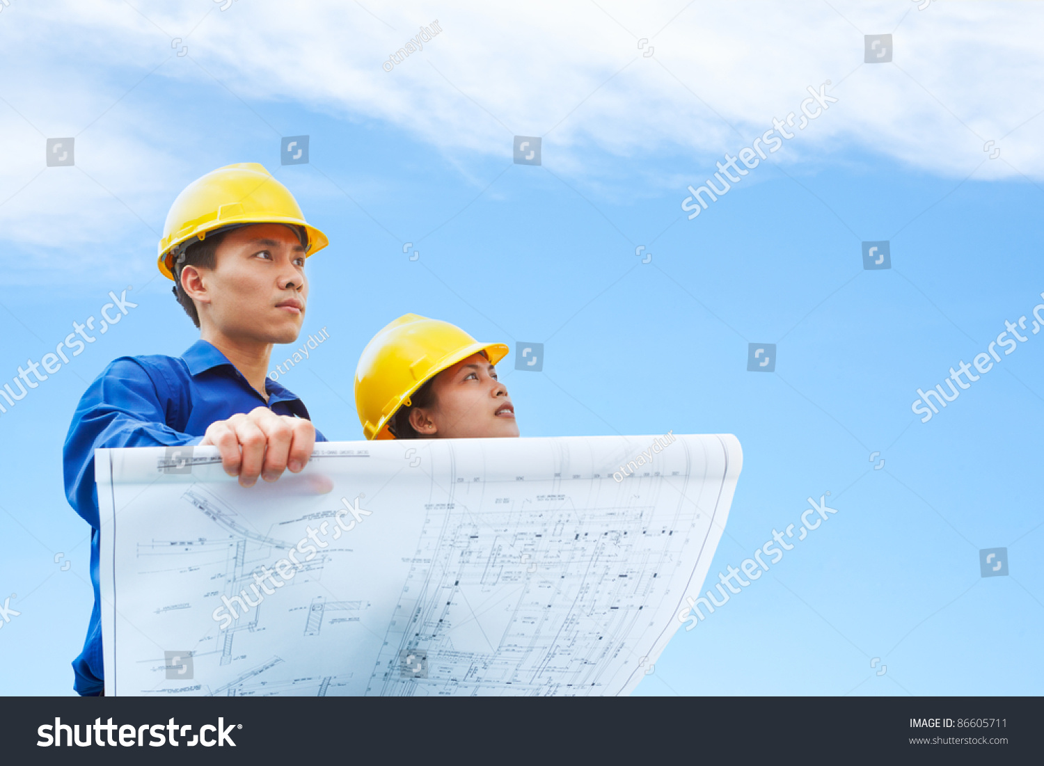 Contractor holding blueprint blue sky background stock photo contractor holding blueprint with blue sky background malvernweather Images